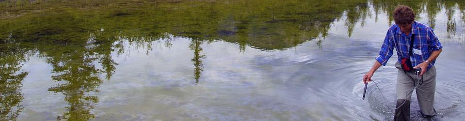 NCC intern takes water samples, Kootenay Rockies, BC (Photo by NCC)