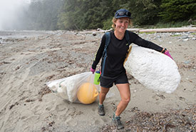 Hauling foam, a buoy and other marine debris during a 2016 Great Canadian Shoreline Cleanup. (Photo courtesy of Rachel Schoeler)