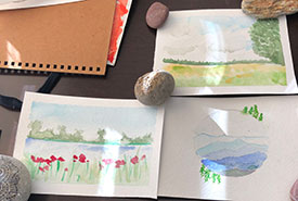 Three watercolour postcards of Canadian landscapes that I'm working on. (Photo by Christine Beevis Trickett/NCC staff)