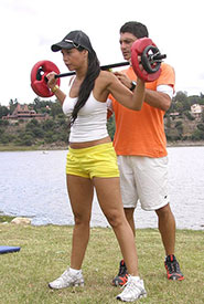 Weight training in park (Photo by Javierlayus, CC BY-SA 3.0)