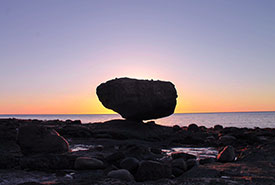 """""""The Balance Rock"""" at sunrise. Visiting this place was one of my first moments in Haida Gwaii and it foreshadowed what I would learn about balance throughout my time there. (Photo by Janel Saydam)"""
