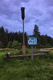 Rocket box maternity roost in Elk/Beaver Lake Regional Park, Victoria, BC with informative sign (Photo by Katie Bell/NCC staff)