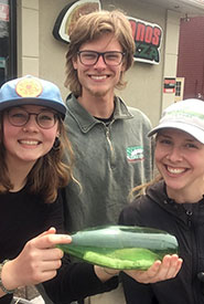 Left to right: Conservation Interns Beth Brooks, Jacob Read, Jenna Cowie and their find. (Photo by NCC)