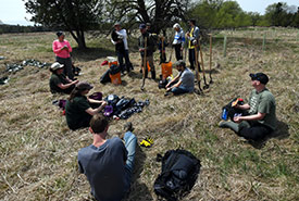 Volunteers receiving instructions on tree planting (Photo by Robert Britton)