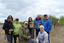 Conservation Volunteers pose with their nest boxes at Edenwold property, SK (Photo by NCC)
