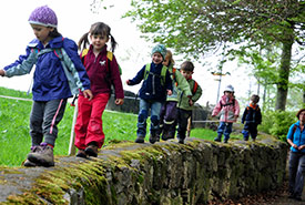 Children exploring the outdoors (Photo by Nature Office for the International Day of Forest Kindergarten)