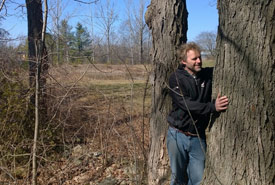 Maximizing the human/tree interface by tree hugging (Photo by Dan Kraus/NCC staff)
