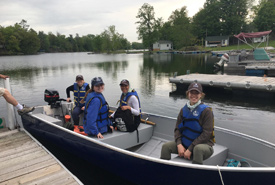 NCC's eastern Ontario team travelling by boat (Photo by NCC)