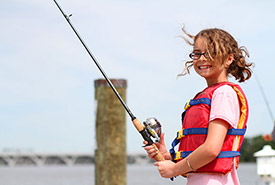 Child enjoying the weather and fishing (Photo by U.S. Fish and Wildlife Services Headquarters, CC BY 2.0)