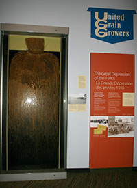 The exhibit case with crested wheatgrass and associated interpretive panel on the Great Depression (Photo courtesy of Manitoba Museum)