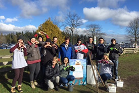 Great Canadian Shoreline Cleanup participants show their love for Canada's shorelines after a day of hard work (Photo courtesy of GCSC)