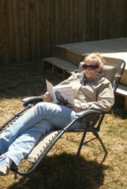 Nerding out in the backyard - note field guide and earbuds (Photo by Jeff Verberne)