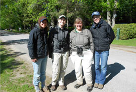 Kristyn (second from the left) wearing binoculars with harness (Photo by David Homer)
