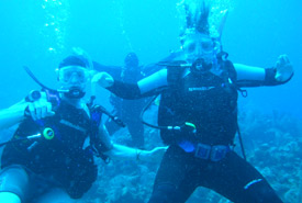 Left to right: Will Cascadden, the divemaster and Katie Cascadden (Photo courtesy of Katie Cascadden)
