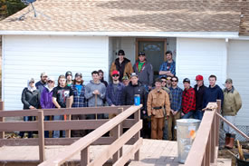 The carpentry classes of 2013 and 2014 working on service learning projects for NCC in New Brunswick (Photo by Steve Austin)