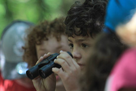 Child using binoculars (Photo by HSBC Bank Canada)