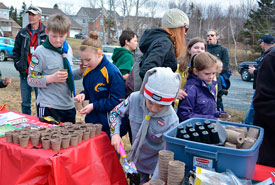 Nova Scotia Scouts planting wildflower seeds (Photo from Scouts Canada)