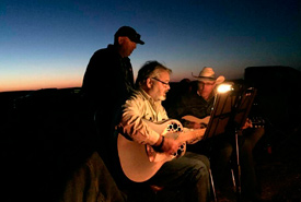 Cliff Schmidt, Craig Dumontel and me playing a few songs around the campfire. (Photo by NCC)