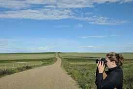 Sarah Ludlow doing a roadside point count survey (Photo by Joseph Poissant)