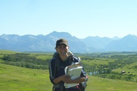 Sheena Briggs doing a property inspection in the Waterton Park Front during her 2008 internship (Photo by NCC)