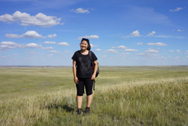 All smiles while posing in front of the picturesque prairies (Photo by NCC)