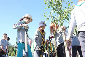 St. Albert and Fort McMurray Scouts planting a symbolic tree (Photo by Shayne Kawalilak)