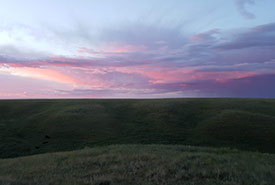 Sunrise at NCC's Wideview property, SK. Sarah Ludlow took this photo while doing point counts on that property. Seeing beautiful sunrises is a perk of early morning bird surveys. (Photo by NCC)