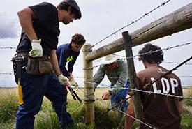 Volunteers and staff working on fence, Haughan, Pakowki AB  (Photo by NCC)