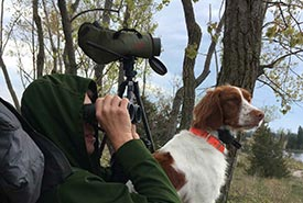 Birdwatching with binoculars (Photo courtesy of Adam Timpf)