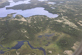 An aerial view of the landscape surrounding the community of Chisasibi, illustrating the vast expanses of open spruce and lichen forests, wetlands and waterways of Eeyou Istchee. (Photo by NCC)