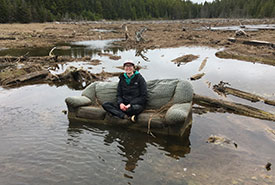 NCC Conservation Biologist Allison Patrick on a couch in the Long Marsh. (Photo by NCC)
