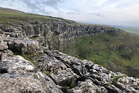 Perhaps the most striking feature at Malham Cove are the 80-metre-high cliffs that stretch approximately 300 metres long. (Photo by Esme Batten/NCC staff)