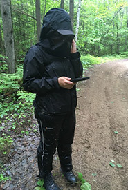Arigna cannot go into the field without her handy mosquito head net. (Photo by NCC)