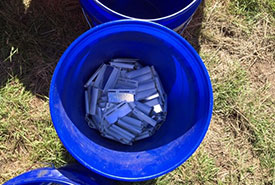 A bucket of fence clips (Photo by Bill Armstrong)