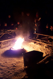 Enjoying a campfire (Photo by Scouts Canada)