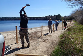 Conservation Volunteers installing fence posts at Turtle Beach (Photo by NCC)