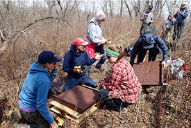 Conservation Volunteers building a bat house (Photo by Lorena Squires)