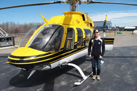 Danielle Horne and helicopter (Photo by NCC)