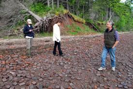 Danielle Horne (NCC), Jamie Fraser (NCC) and John Caraberis on the brick beach, NS (Photo by NCC)