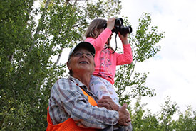 Conservation Volunteer Denise Harris shares her love for nature with her granddaughter (Photo by NCC)