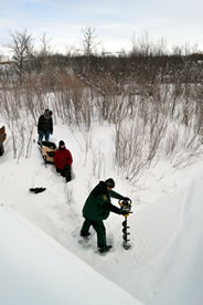 Drilling hole in creek (Photo by NCC)