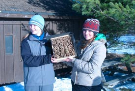 Emily Wassmansdorf and Stephanie Aultman with their finished bee box. (Photo courtesy Scouts Canada)