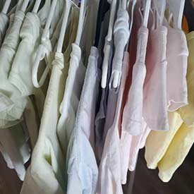 A rack of shirts dyed with natural colouring. (Photo by Sage Yathon)
