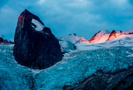 First light hitting the Pigeon Feathers. Houndstooth Peak is the prominent peak coming out of Bugaboo Glacier. Bugaboo Group in the Purcell Mountain Range, BC (Photo by Neil Ever Osborne)