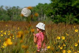 Child playing in nature (Photo by Cathy Shaluk)
