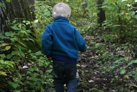 Child walking in the woods (Photo by Lisa Grilz)