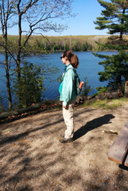 Taking in the scenery on a day hike at Awenda Provincial Park. Note the layered clothing and sturdy footwear. (Photo by Jason Snell)