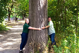 Anwar Knight and I hugging a black oak tree in High Park.  (Photo courtesy of Anwar Knight)