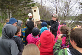 Kathy Unger (NCC) and Danielle Fequet (DUC) showing the students a nest box prior to installation (Photo by NCC)