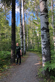 Having a moment with a beautiful jack pine in northern Ontario. (Photo by NCC)